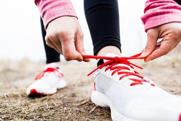 bigstock-Woman-Runner-Tying-Sport-Shoes-52582435-e1389483277161